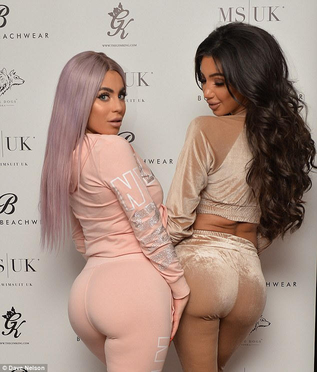 Bottoms up! The CBB star, 26, dazzled in a figure-hugging black gown before slipping into skintight velour tracksuit bottoms to pose with Katie Salmon