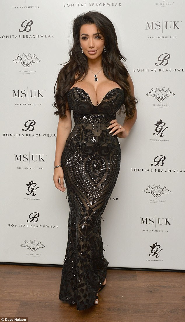 Busting out! Chloe Khan showed off her very ample assets and hourglass curves in a plunging black fishtail gown atthe Miss Swimsuit heats at Sugar Hut in Essex on Thursday night