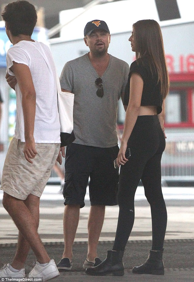 Getting touchy: The actor, 40, was spotted taking a stroll with the 23-year-old German model and was even seen grabbing her arm