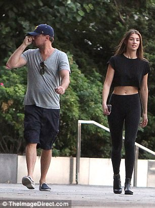 He likes them young! Leo's love interest also teamed her casual-chic look with black boots, while wearing little make-up and her brown glossy hair down