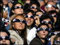 Crowds watch a solar eclipse