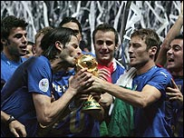 Italy celebrate with the World Cup trophy