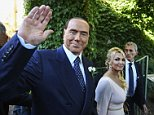 Former Italian Prime Minister Silvio Berlusconi (pictured with his partner Francesca Pascale) was all smiles on Friday as he attended the wedding of his partner's sister