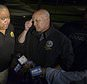 From left, New Orleans Police Superintendent Michael Harrison talks to the media, as Mayor Mitch Landrieu and 7th District Commander Lawrence Dupree, right, listen outside University Medical Center, early Friday, Oct. 13, 2017 in New Orleans, La.  A New Orleans police officer was shot and killed early Friday, ambushed while getting out of a patrol car to investigate something which had aroused suspicions on the city's east side, police said.   (Matthew Hinton/The Advocate via AP)