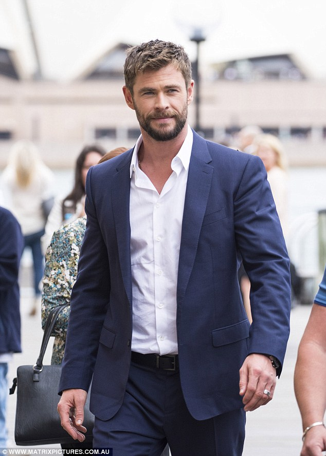 Thor blimey he looks sharp! Chris Hemsworth (seen) dresses up in a suit as he joins Ragnarok director Taika Waititi and co-star Mark Ruffalo in Sydney