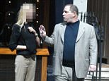Harvey Weinstein was pictured arguing with a 'visibly distressed' blonde woman outside a restaurant on the streets of London in 2003