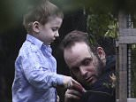 Joshua Boyle is seen playing with his son Najaeshi Jonah the garden of his parents' home in Smith Falls, Ontario on Saturday. Boyle, his wife and their three kids were freed on Wednesday