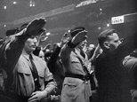 This Nazi rally in Madison Square Garden attracted 20,000 people in 1939 - while banners with Nazi swastikas hung next to a picture of George Washington (both seen leftleft)