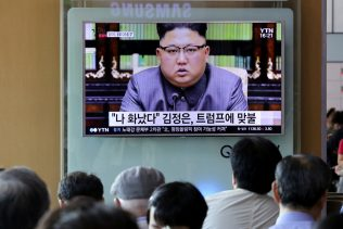 People watch a TV screen showing an image of North Korean leader Kim Jong Un delivering a statement in response to U.S. President Donald Trump's speech to the United Nations, in Pyongyang, North Korea, at the Seoul Railway Station in Seoul, South Korea, Friday, Sept. 22, 2017. (AP/Ahn Young-joon)