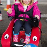 Little girl playing football in her Wizzybug