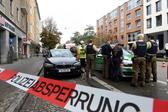 German police stands inside a security perimeter set after a man attacked passersby near Rosenheimer square in the southern German city of Munich on October 21, 2017 (Christof Stache/AFP)