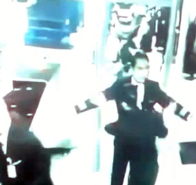 Footage: Co-pilot Fariq Hamid who was also searched before the pair walked onto the plane