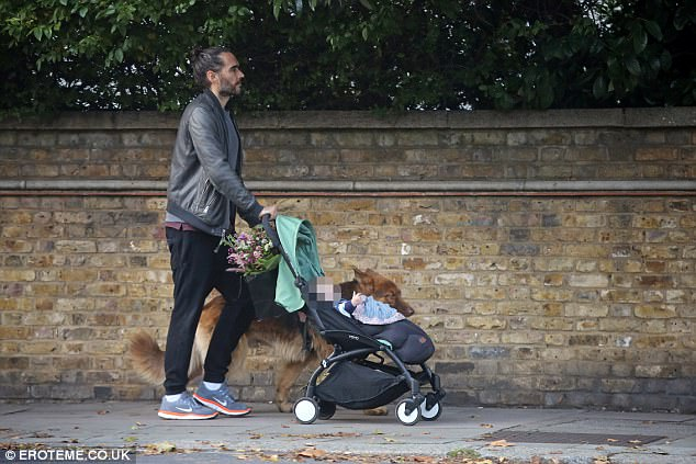 Off he goes: Russell seemed eager to head home as he pushed the pram down the street