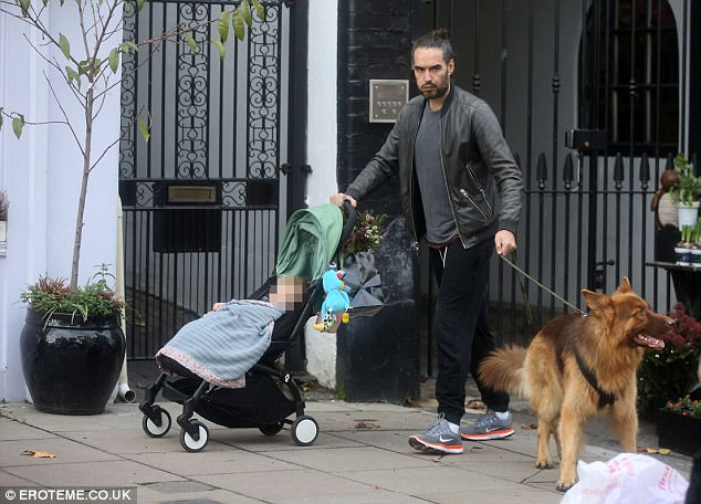 Off he goes: Russell had to pull in Bear after the pet pooch got excited by the passersby