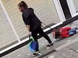Shocking: Footage shot in Liverpool has emerged appearing to show a woman dragging a child up a high street by the leash of its harness