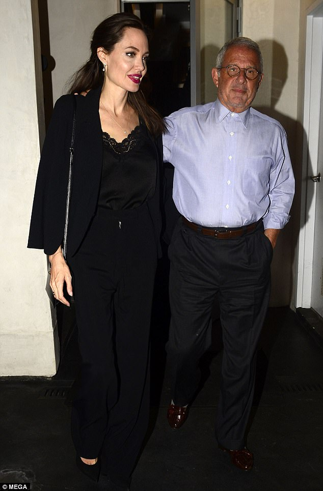 On-the-go: Angelina Jolie was spotted heading to dinner at Umeda Sushi in Los Angeles on Monday night with a male friend