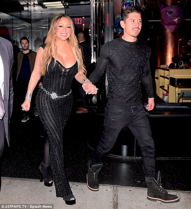 Happy couple:The star brought her toyboy beau Bryan Tanaka, 34, to the star-studded event, with the singer seen holding hands and smiling as she stepped out with her man
