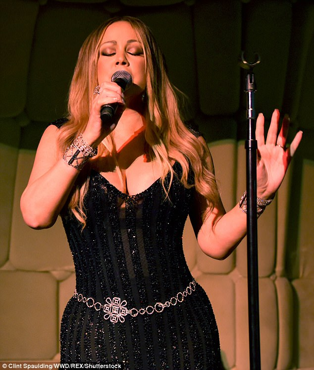 Tune up:The Star songstress wore a striped black dress decorated with black sequins as she hit the stage to belt out some of her hits