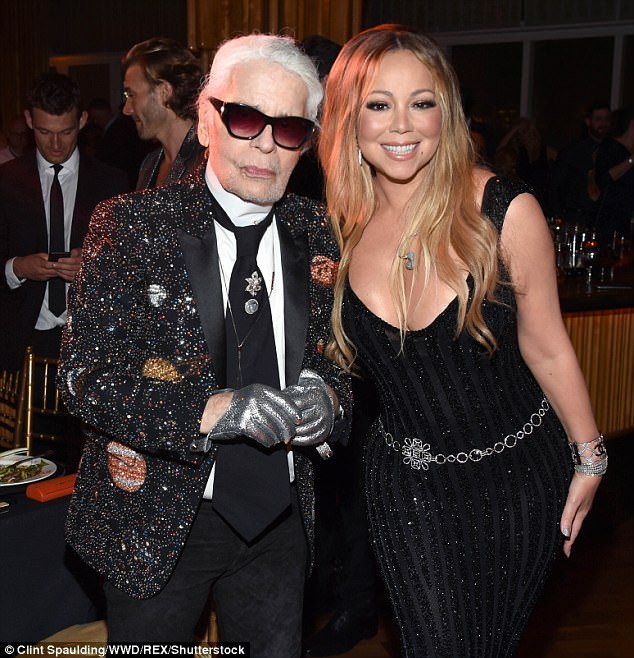 Splendid:The star posed up with the man of the hour Mr Lagerfeld, who wore his trademark sunglasses even indoors and at night at the event in penthouse lounge The Top of the Standard