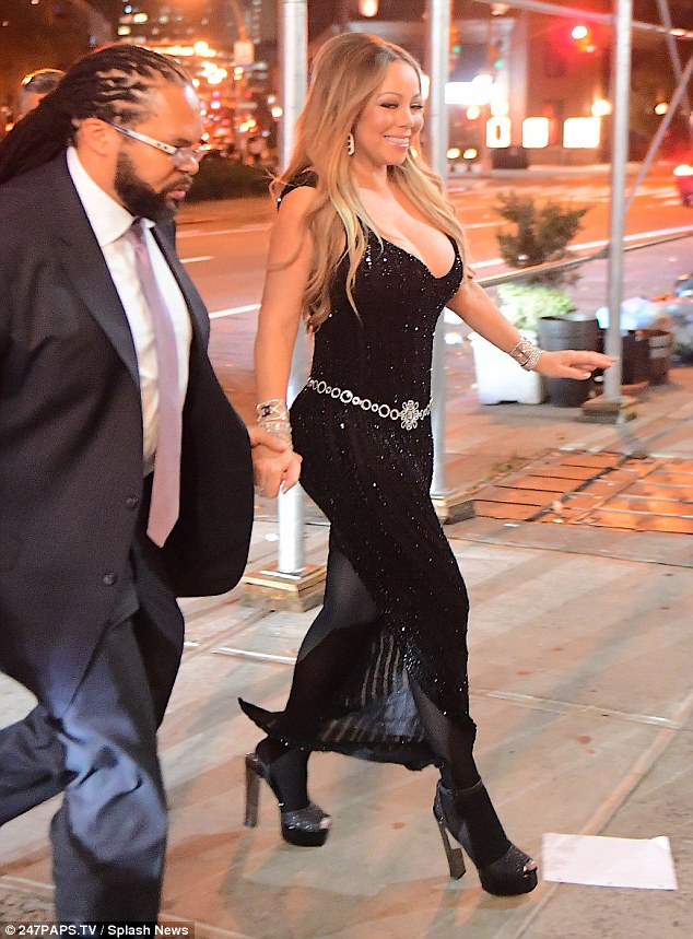 Wow factor:The 47-year-old vocal powerhouse slipped her toned curves into a skintight glittery black dress, which highlighted her taut midriff and tiny waist as she strutted to the event at The Top of the Standard in New York City on Monday