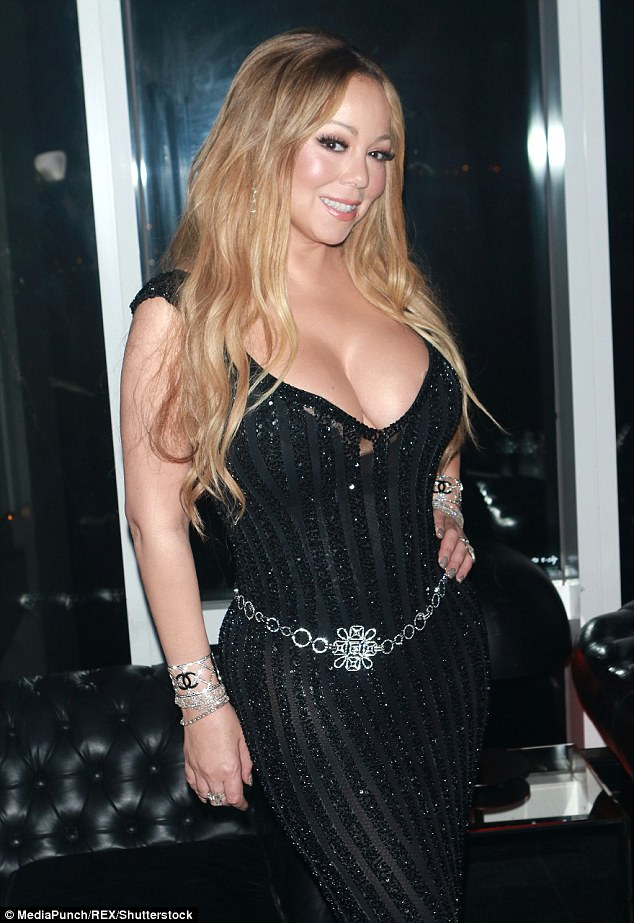 Busty: Mariah Carey bounced back from ex fiance James Packer's revelations as she flaunted her dramatically slimmer frame at Karl Lagerfeld's V Magazine's dinner in NYC on Monday, as well as the $10m engagement ring he gave her (pictured on the middle finger of Mariah's right hand)
