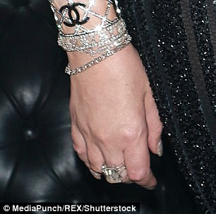 Mammoth:Making no efforts to hide her continued efforts to wear the ring, Mariah slipped the mammoth 30-carat diamond ring onto the middle finger of her right hand, where it caught the light among her many other glittering accessories