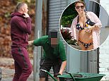 Community service: Wayne Rooney looks glum as he arrives at a community centre to paint benches - as his pregnant wife Coleen tops up her tan on another sunshine holiday