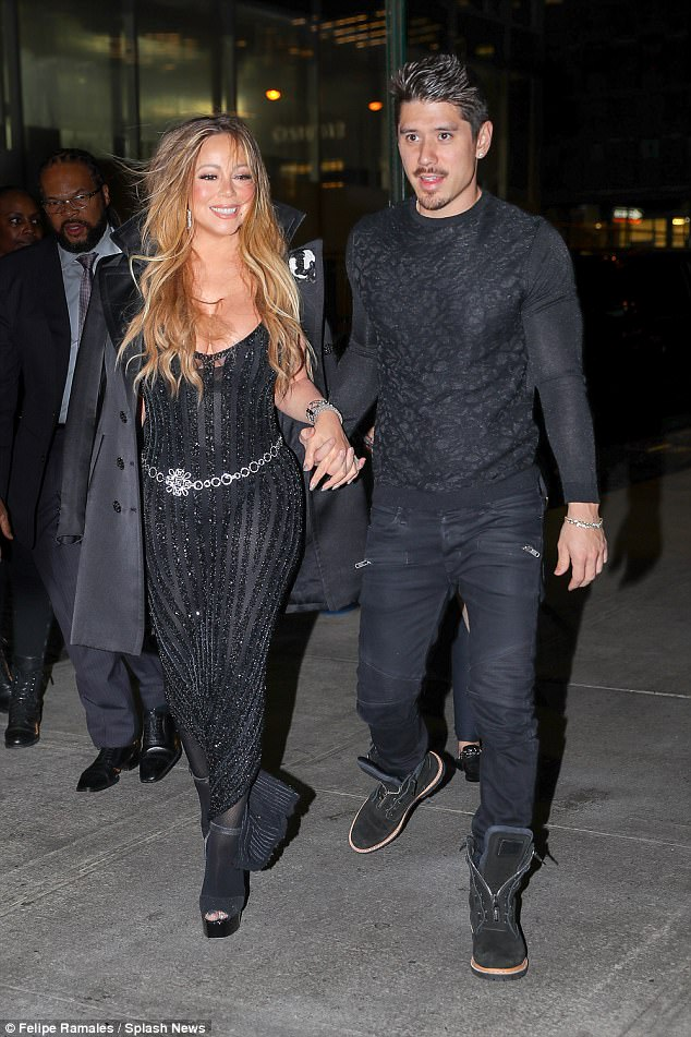 Relaxed: Bryan matched Mariah in a black ensemble as they strolled along