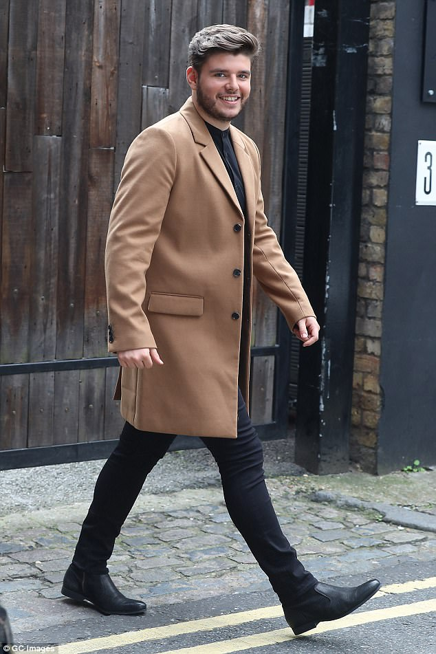Trendsetter: Lloyd Macey put the nerves to one side as he made a stylish appearance in a camel-coloured coat