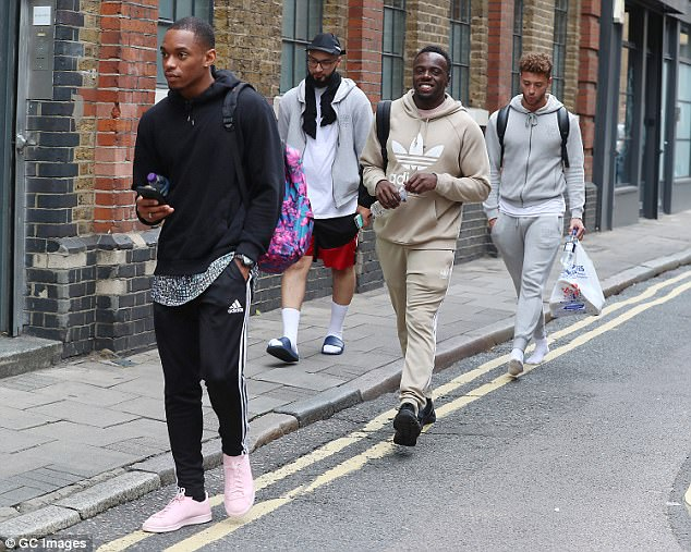 Excited: Boyband Rak-Su looked undeniably trendy as they made their way to the studio