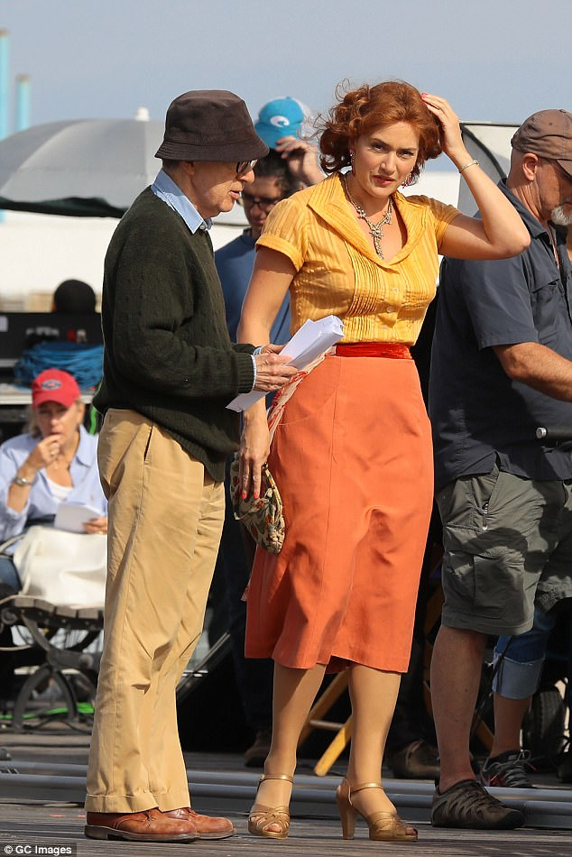 Working together: Kate is pictured with Allen on the set ofWonder Wheel last year; she playsGinny, a bored 1950s wife who has an affair with Justin Timberlake's young lifeguard