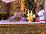 Ceremony: Thailand's new kingpicks bits of his father's charred bones and remains to be enshrined as relics following a spectacular cremation last night