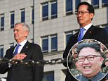 North Korea has conducted mass evacuation drills in towns across the country as possible 'preparation for war,' it was reported on Saturday. The photo above, which was released in August 2017, shows North Korean ruler Kim Jong-un (center) alongside military officers