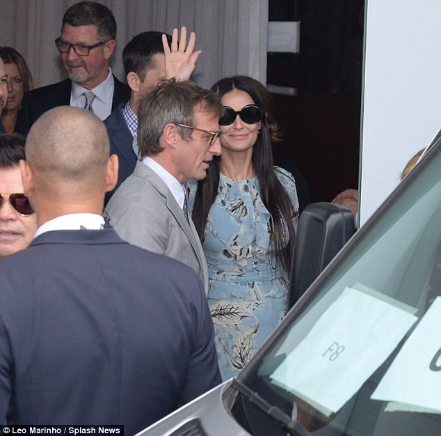 Could be awkward:Ashton Kutcher and Demi Moore reunite in Rio as the biggest names in music and film flock to Madonna's manager's $250k wedding on Tuesday