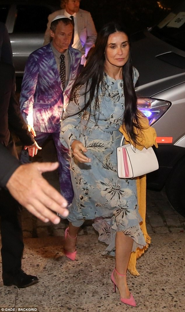 Simply stylish: Demi, 54, looked lovely in a floaty light blue patterned frock with long sleeves. She added pink heels and left her long raven locks loose
