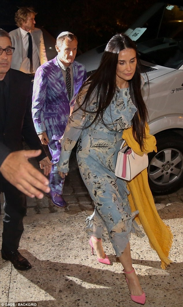 V.I.P. guests: Demi was followed into the private residence by Flea from the Red Hot Chili Peppers, in a purple tie dye suit and matching shoes, and actor Owen Wilson in a jacket and tie