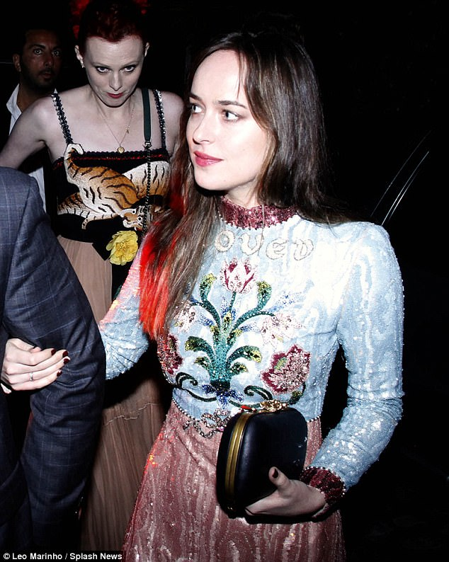 Celebrity offspring: The actress daughter of Hollywood stars Melanie Griffith and Don Johnson wore her long dark hair loose with a center parting and sported bright red lip color