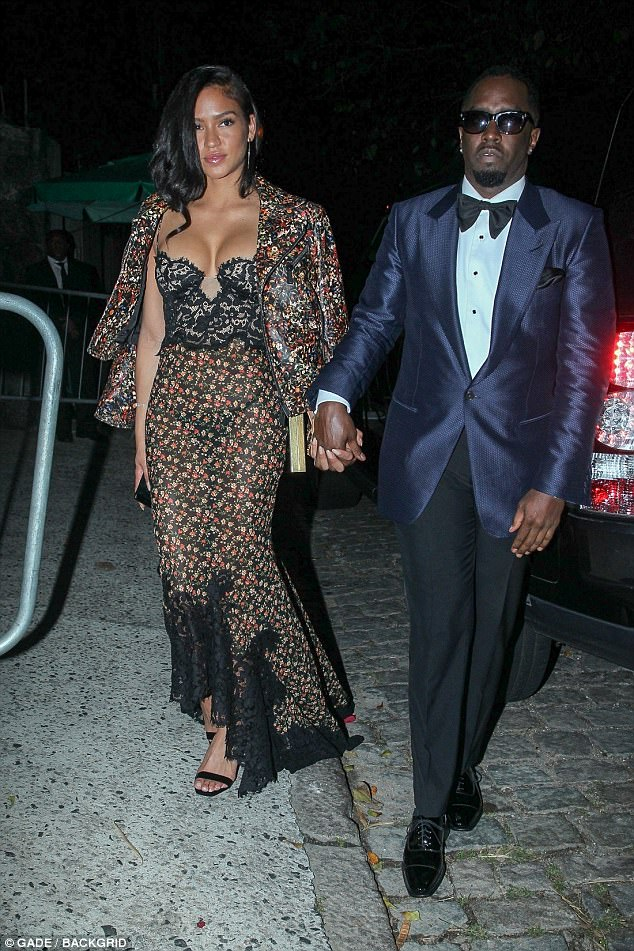 Ready to party: Sean Combs showed up with girlfriend Cassie, 31, who looked stunning in a patterned dress with black bustier bodice and asymmetrical hem paired with matching jacket