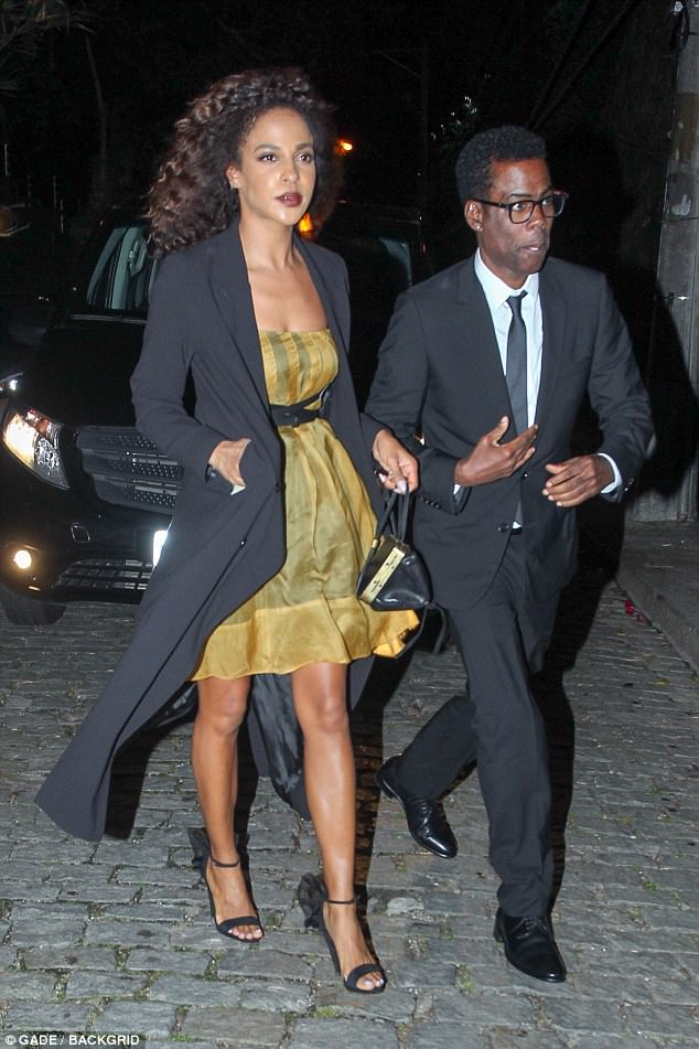Guests: Comedian and actor Chris Rock, 52, was stylish in a dark suit and tie while partnerMegalyn Echikunwoke, 34, showcased her legs in a yellow mini dress and black coat