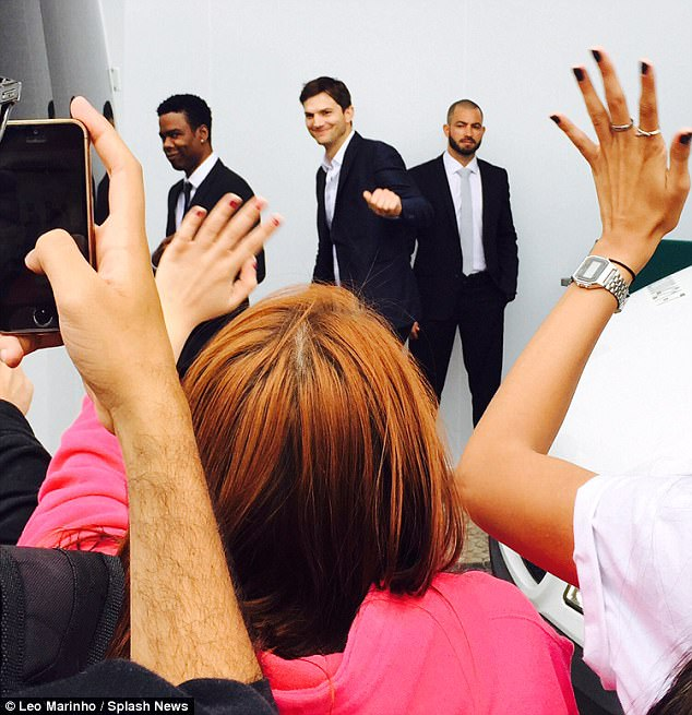 Mobbed: Brazilian fans waved and took photos on their smartphones as the celebrities passed by