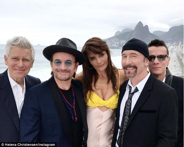 Starry eyed:No newcomer to fame, Helena Christensen  posed for a picture with U2