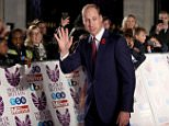 Prince William looked dapper in a navy suit on the red carpet at the Pride Of Britain Awards