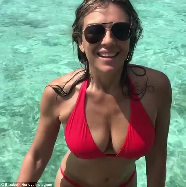 Chest a glimpse: The Bedazzled star highlighted her ample cleavage in the halterneck bikini top as she slowly walked out of the crystal clear water with confidence