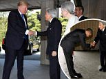 SLIGHT NOD OF THE HEAD: President Donald Trump shook hands with Japanese Emperor Akihito as the two met at the Imperial Palace on Monday