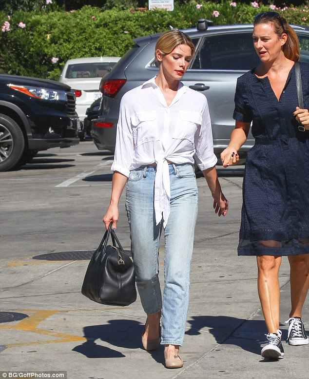 California girl: The actress, 30, wore a stylish Faithfull the Brand blouse, tying the front of its hem into a knot and offering a glimpse of toned midriff