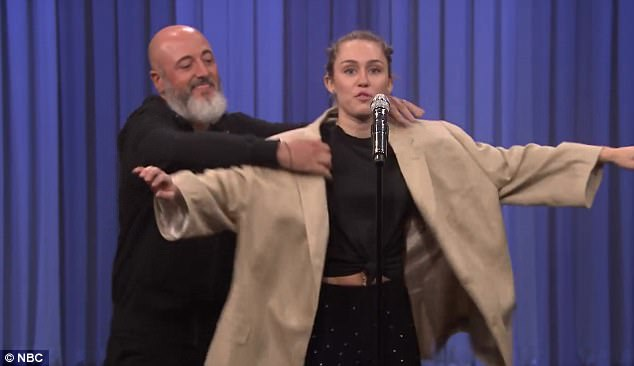 Authentic: For her final act, Miley brought out props that included a gigantically oversized tan overcoat and eyeglasses to sing along to Once In A Lifetime by the Talking Heads