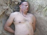 Boxing coach Ramon Sosa staged his own murder and posed up for this picture of his 'corpse'