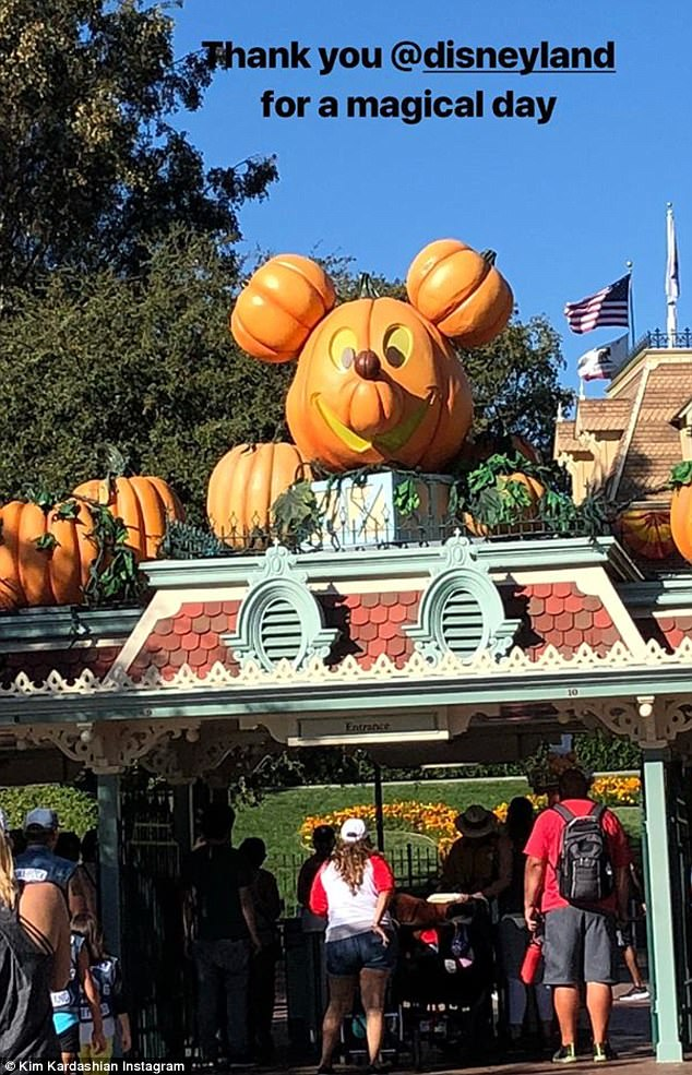 Family fun day:'Thank you @disneyland for a magical day,' she captioned a photo of the park's entrance