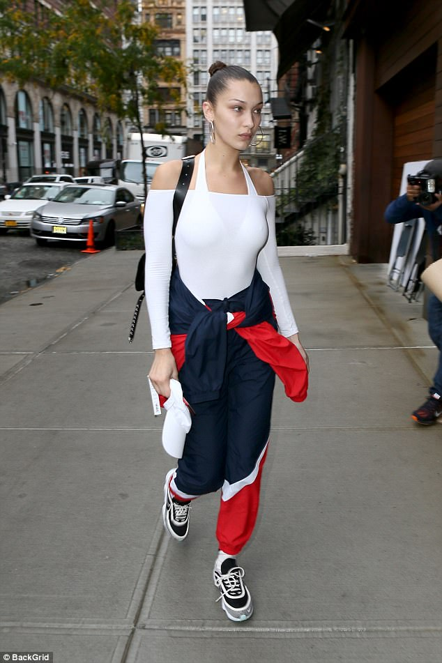 Hitting her stride! The rest of the catwalk queen's look was sporty and patriotic, as she rocked a pair of navy track pants with white and red stripes