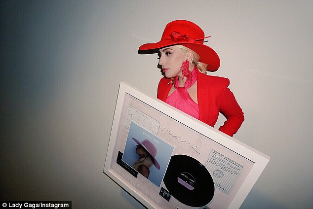 Proud:The hit-maker took to Instagram to share photos of herself holding up the achievement, along with the victorious message: 'Feels good for #Joanne to be Platinum in the United States, w/ an album I made so from my (heart emoji)'